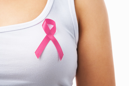 Close up of pink badge on woman chest to support breat cancer cause, PS: you can change the ribbon color to red to support AIDS cause as both using same symbol